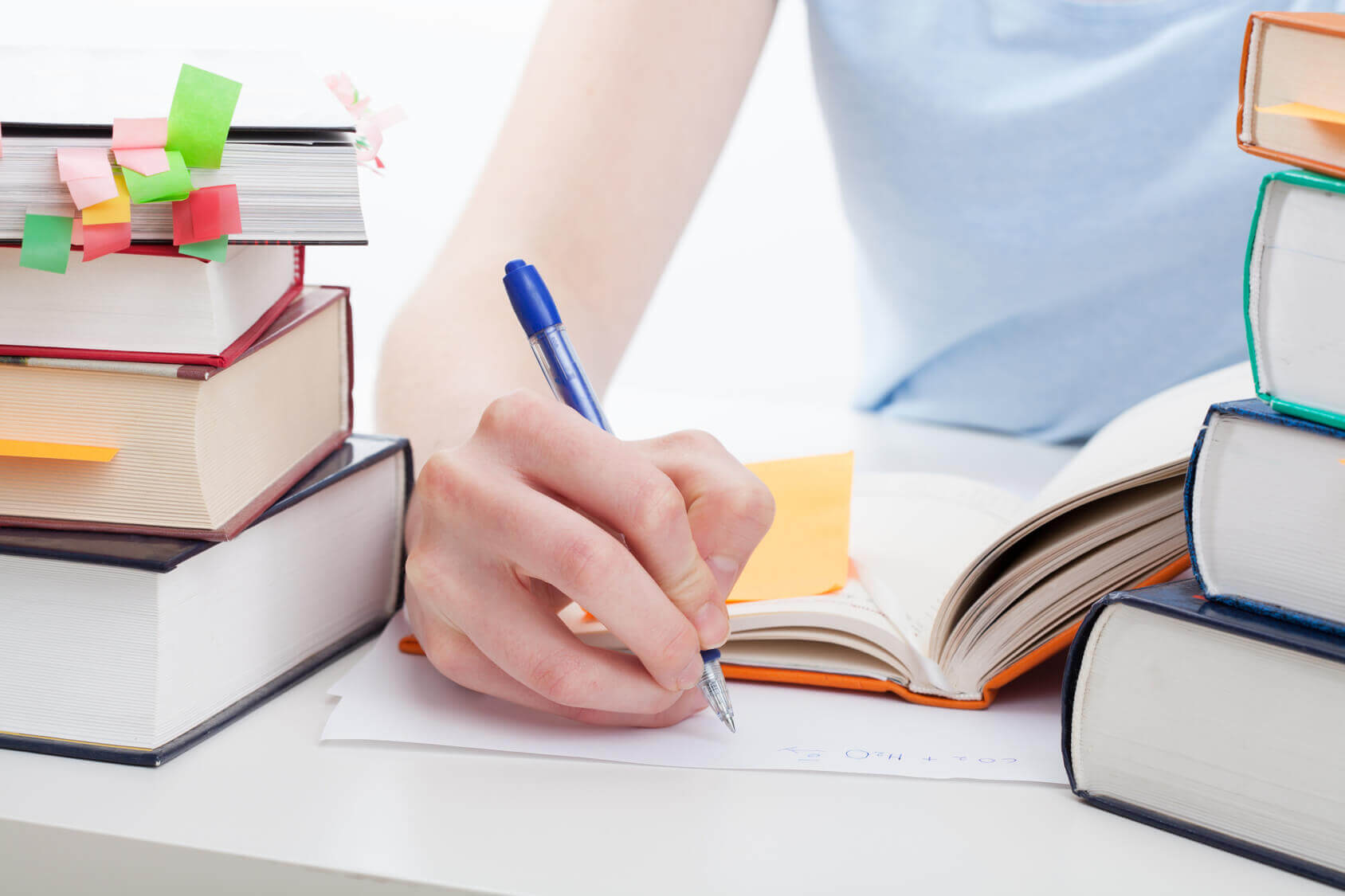 Student writing her UNISA study notes